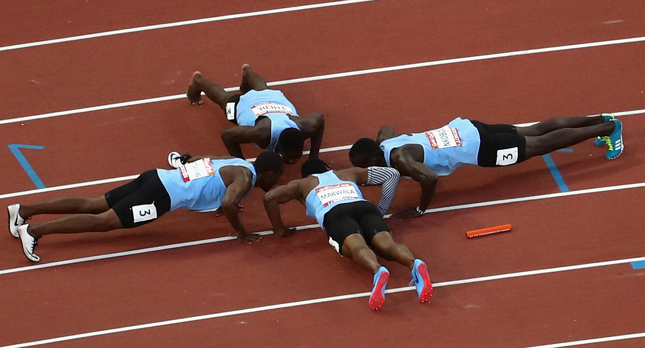 Botswana celebrate men's 4x400 gold medal with push-ups.