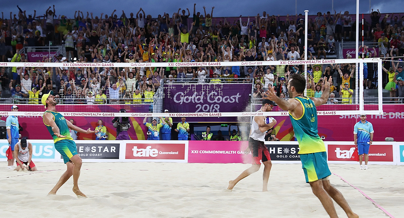 Damien Schumann and Christopher Mchugh of Australia celebrate winning match point in the Beach Volleyball Men's Gold Medal match between Damien Schumann and Christopher Mchugh