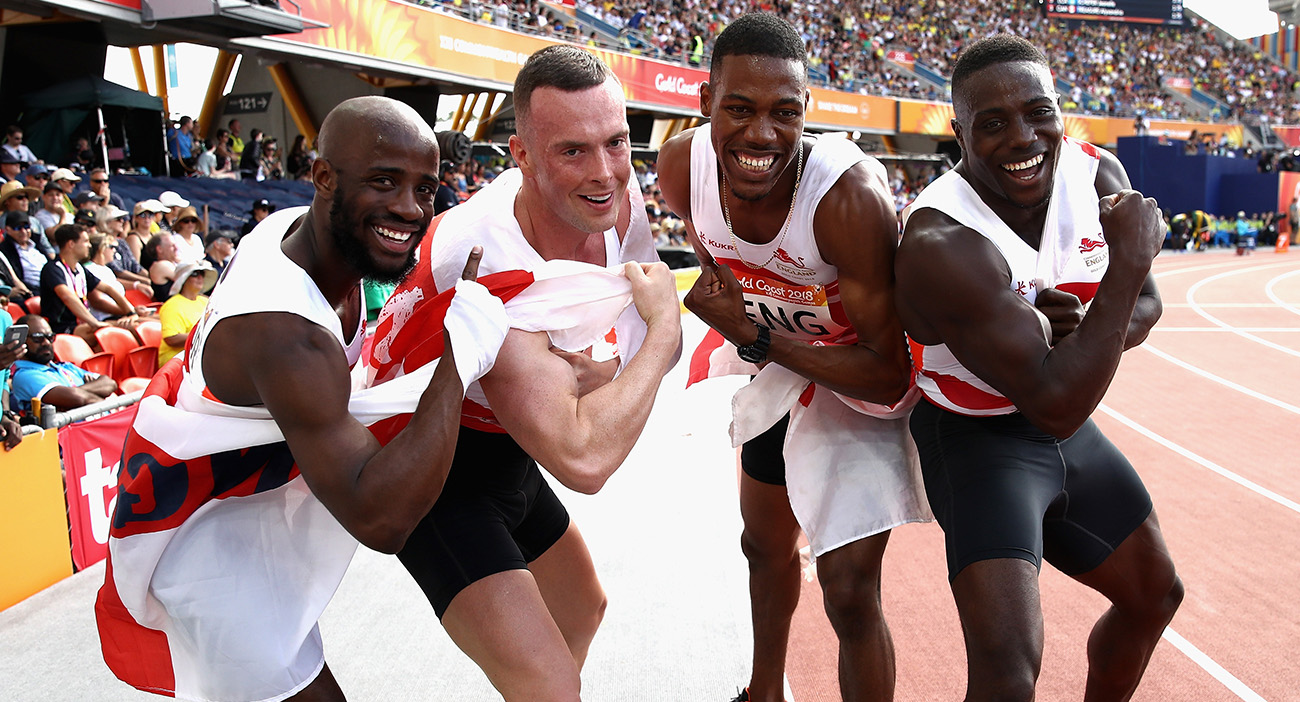 Harry Aikines-Aryeetey, Reuben Arthur, Zharnel Hughes and Richard Kilty of England celebrate as they win gold in the Men's 4x100 metres