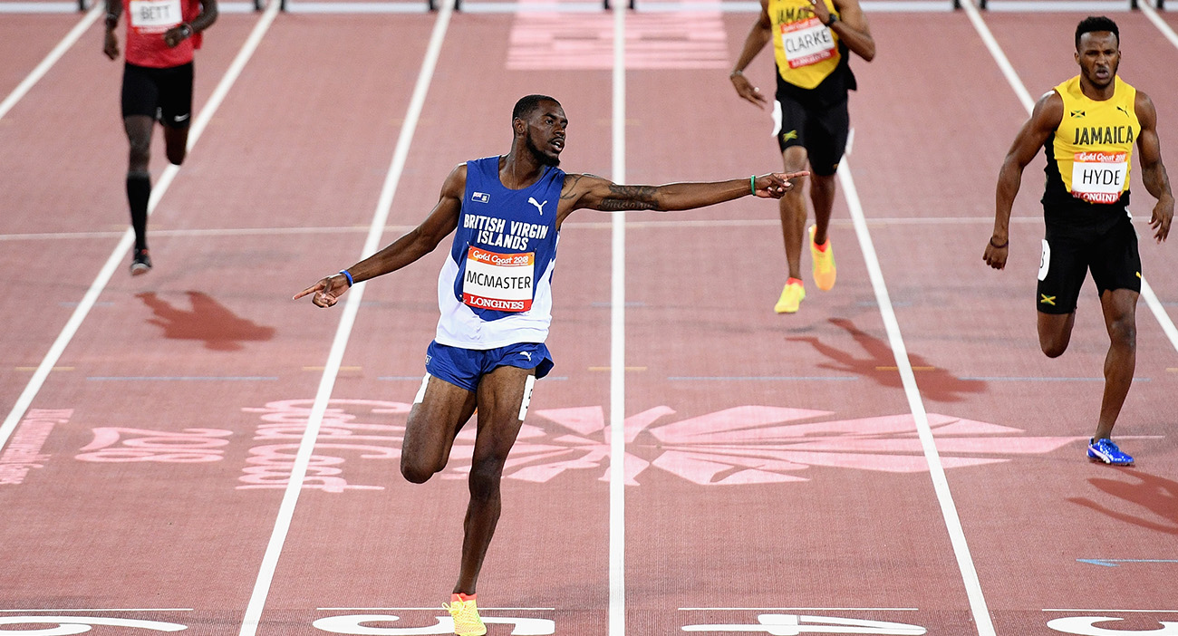 Kyron McMaster of Virgin Islands, British celebrates as he crosses the line to win gold in the Men's 400 metres hurdles