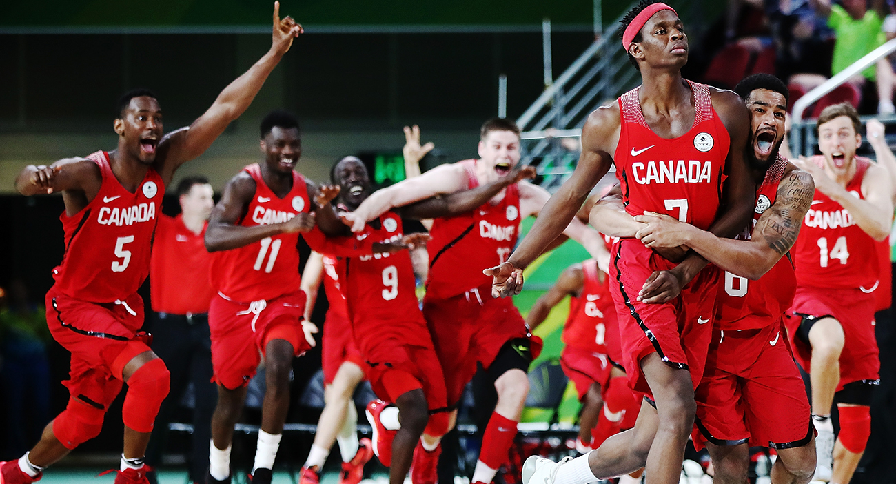 Mamadou Gueye of Canada celebrates with the team after shooting the winning shot to win the Men's semi-final match between New Zealand and Canada Basketball