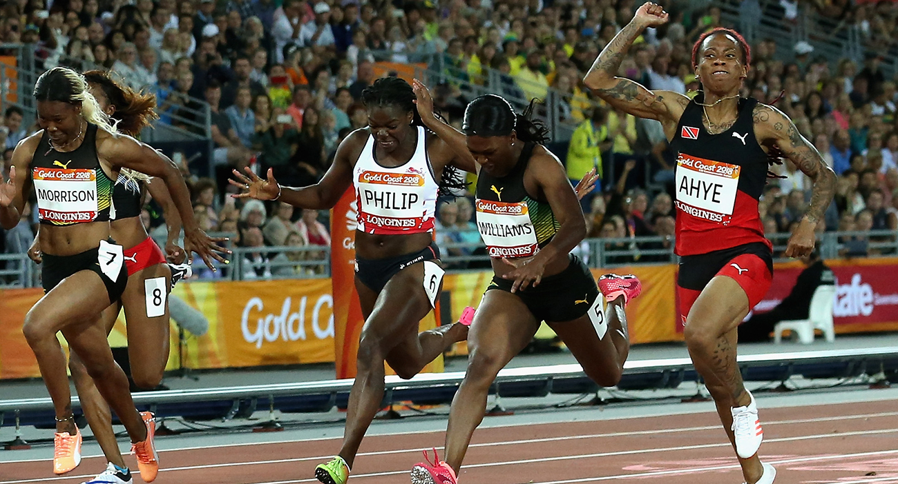 Michelle-Lee Ahye of Trinidad and Tobago celebrates as she wins gold ahead of Christania Williams of Jamaica and Asha Philip of England