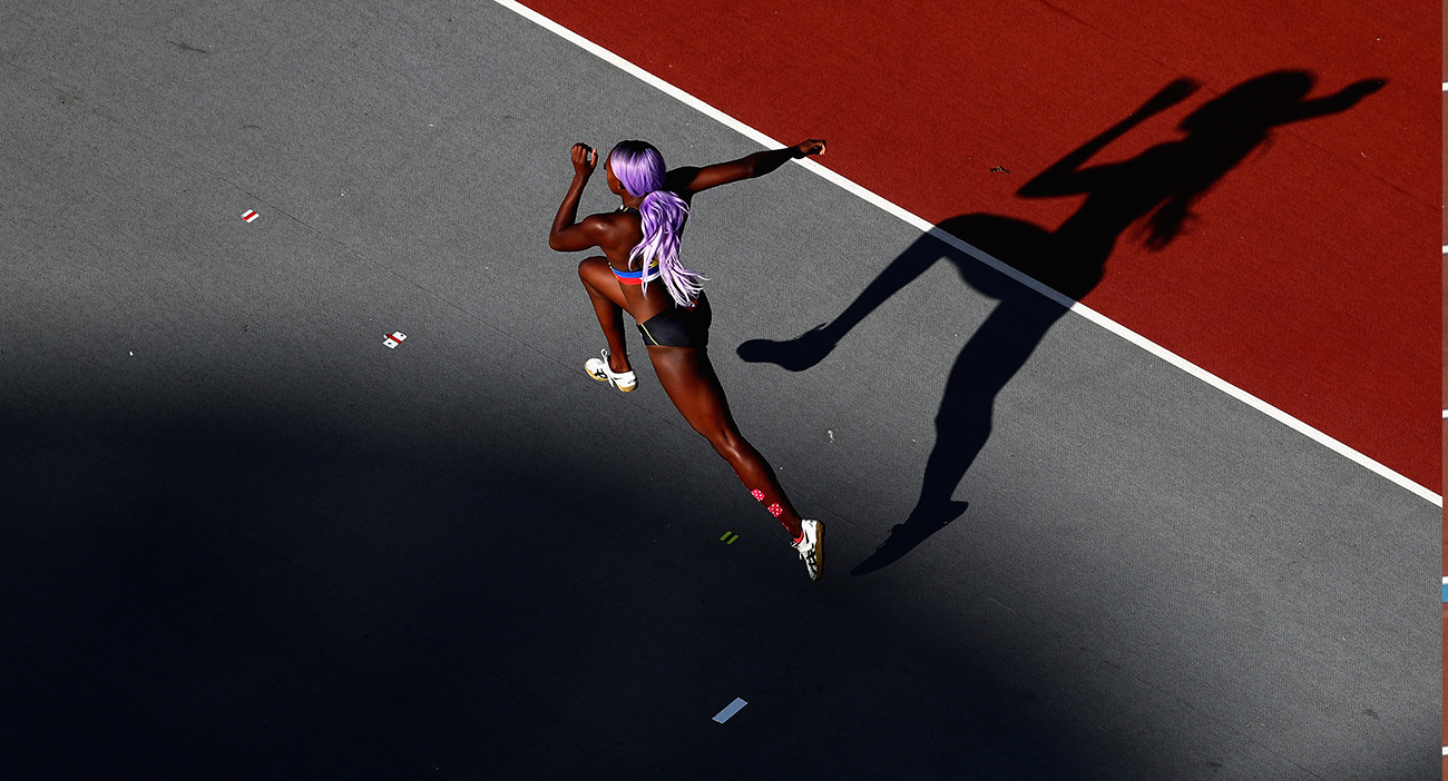 Priscilla Frederick of Antigua and Barbuda competes in the Men's High Jump final during athletics