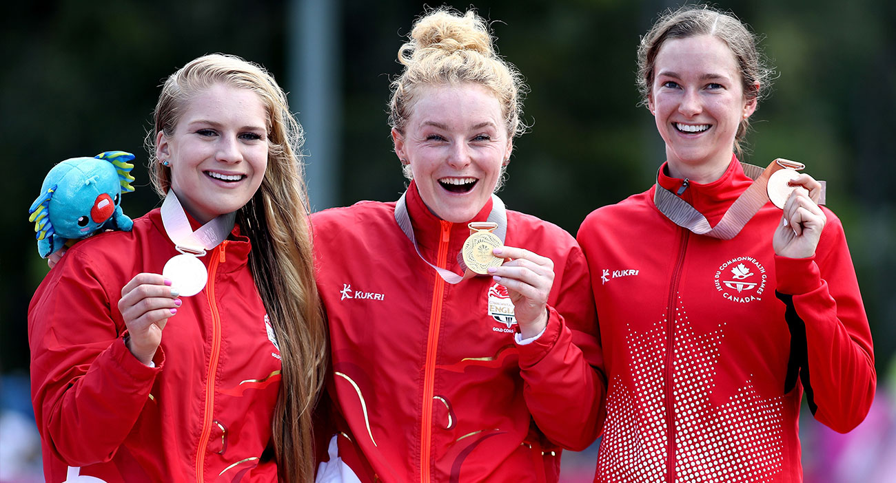Silver medalist Evie Richards (England), gold medalist Annie Last (England) and bronze medalist Haley Smith (Canada) medal ceremony for the Women's Cross country.
