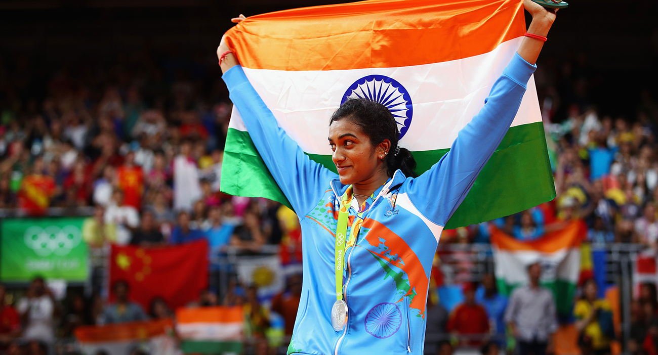 Silver medalist V. Sindhu Pusarla of India celebrates during the medal ceremony after the Women's Singles Badminton competition on Day 14 of the Rio 2016 Olympic Games