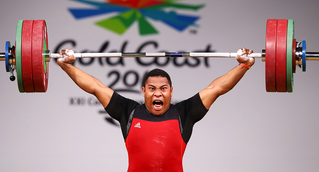 Steven Kari of Papua New Guinea celebrates his winning lift during Weightlifting on day four of the Gold Coast 2018 Commonwealth Games at Carrara Sports