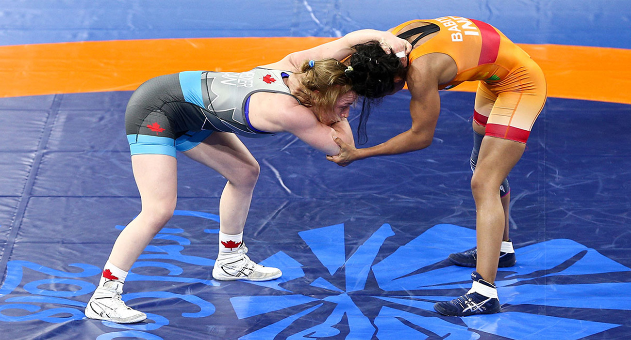 Canada's Diana Weicker and India's Babita Kumari wrestle in the gold medal match