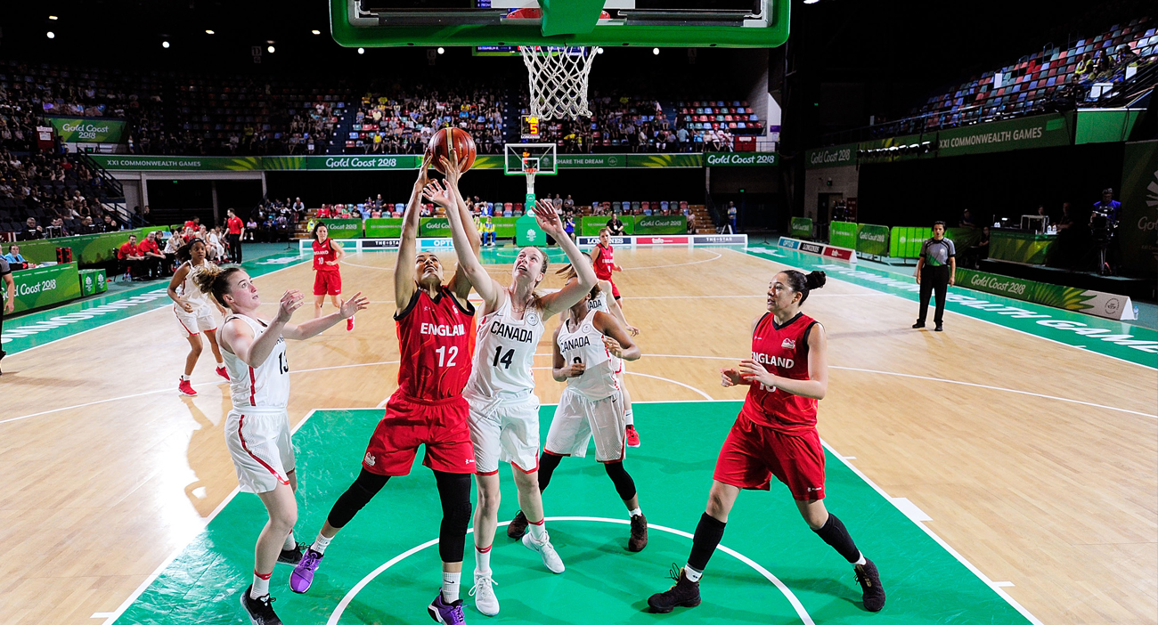 Chantelle Pressley of England and Alex Kiss-Rusk of Canada contest the ball during the women's Pool A Basketball match
