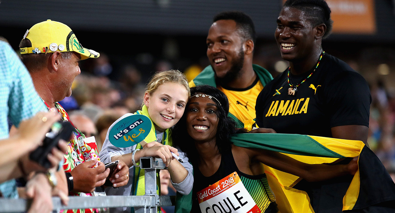 Fedrick Dacres of Jamaica celebrates winning gold with silver medalist Traves Smikle of Jamaica alongside 800 metres brone medalist Natoya Goule of Jamaica after the Men's Discus final