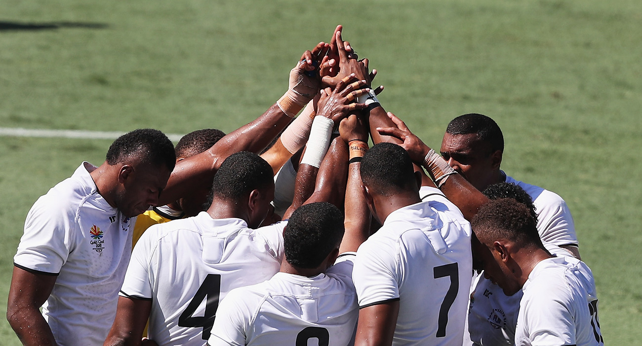Fiji form a huddle at the Rugby Sevens