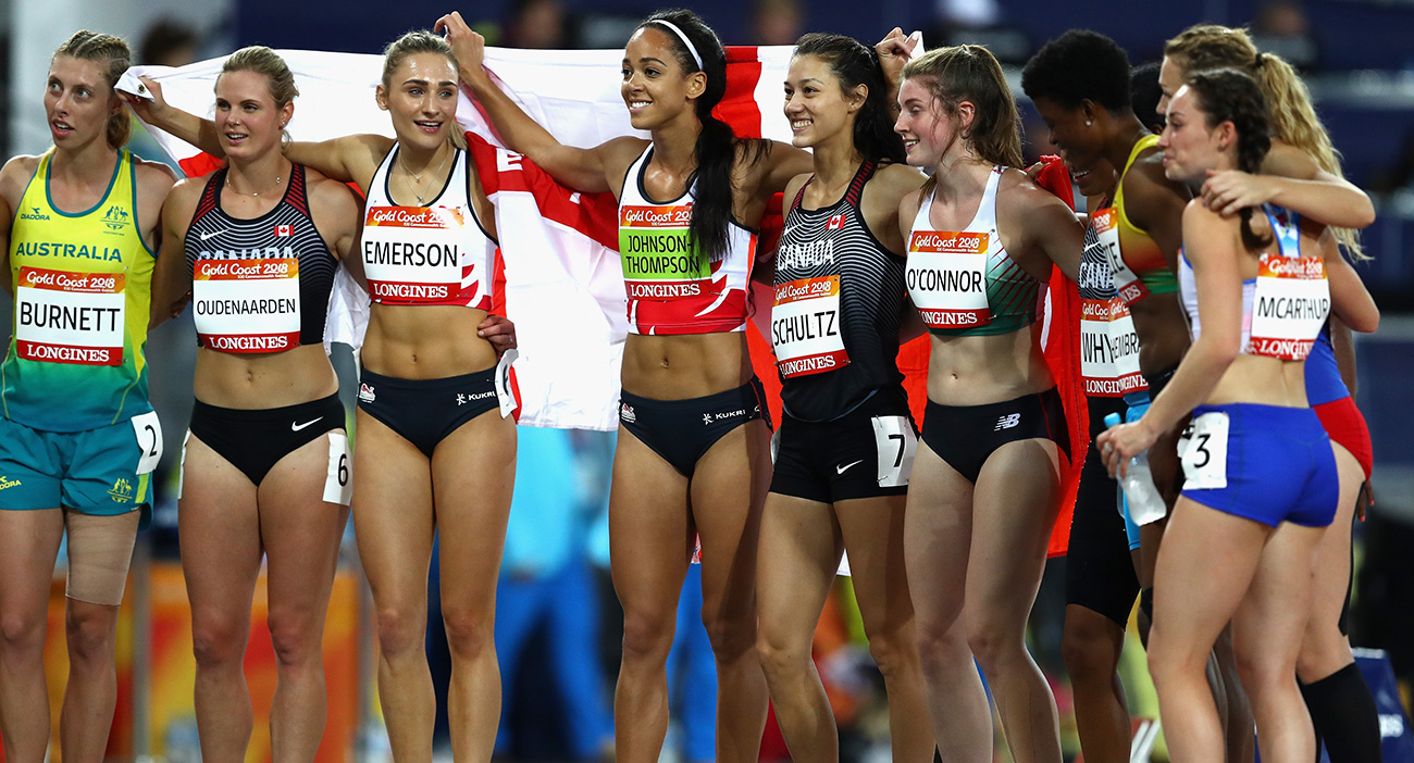 Silver medallist Nina Schultz of Canada, gold medallist Katarina Johnson-Thompson of England and bronze medallist Niamh Emerson of England celebrate with fellow athletes after the Women's Heptathlon 800 metres