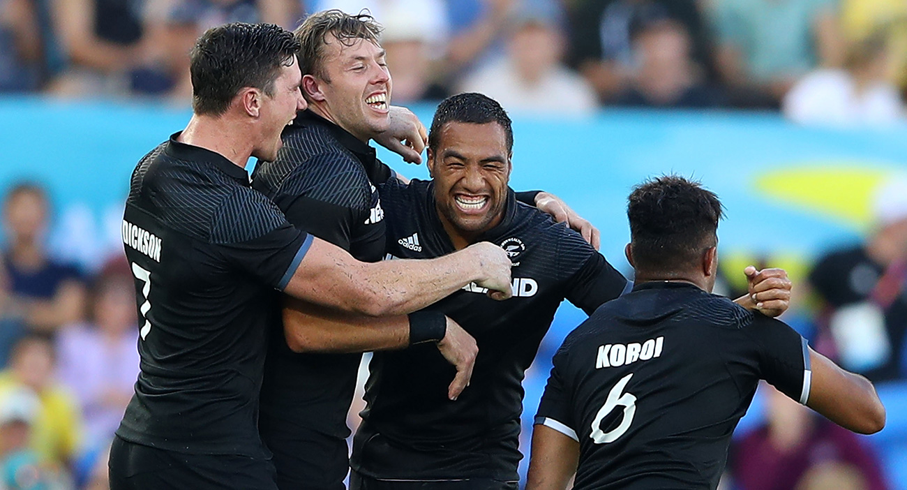 The New Zealand Rugby Sevens team celebrate winning the men's gold medal match