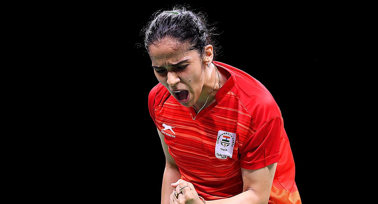 Saina Nehwal of India celebrates during the Badminton Mixed Team gold medal match against Soniia Cheah of Malaysia
