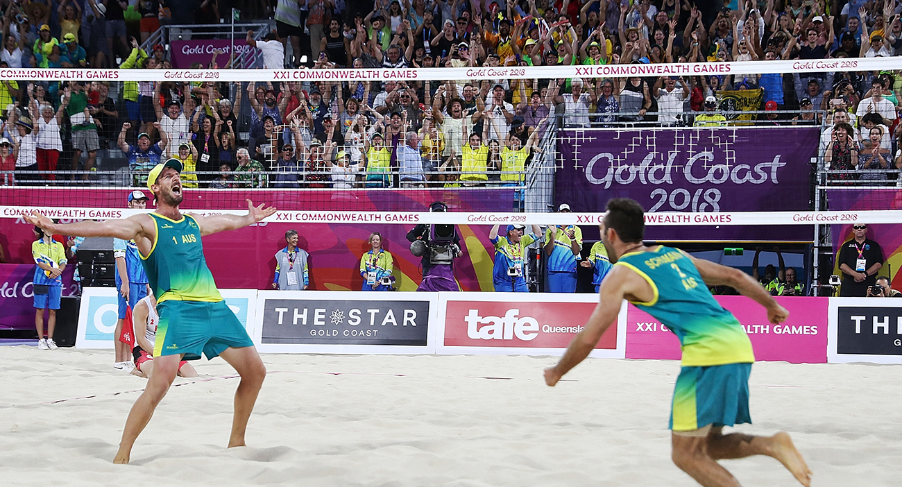 Damien Schumann and Chris McHugh of Australia celebrate winning match point in the Beach Volleyball