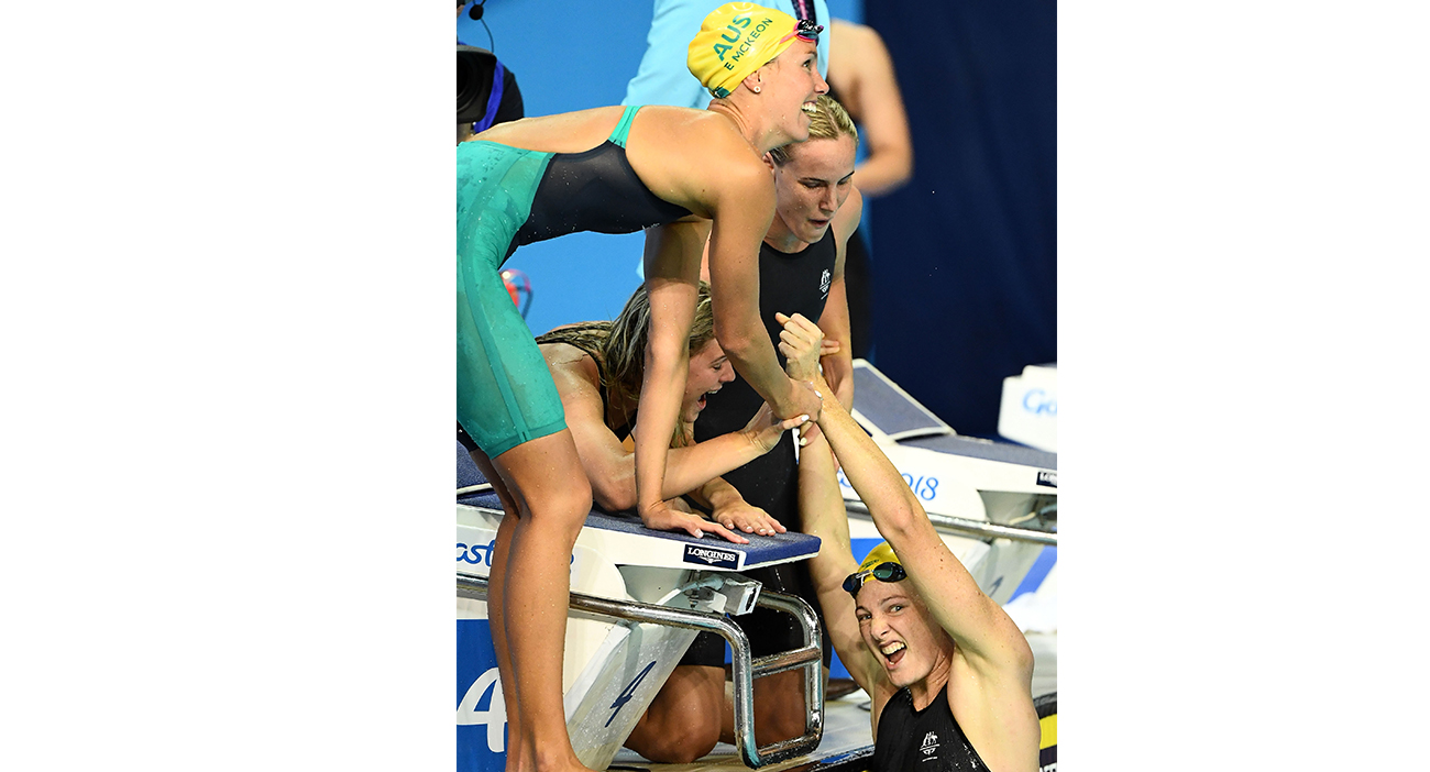 Australian women's 4x100m relay team celebrate their world record and gold medal.