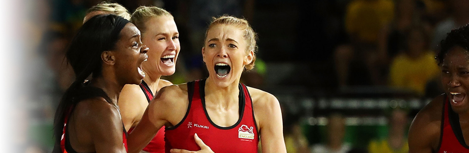 England players celebrate after winning a thrilling netball final.