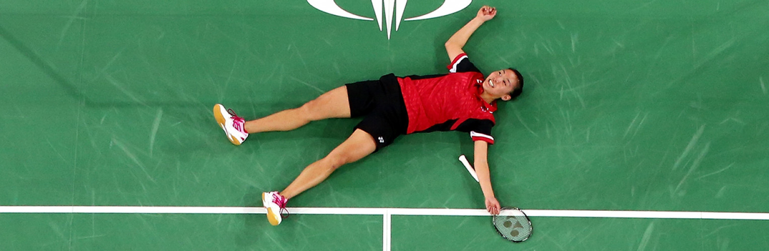 Michelle Li celebrates winning the gold medal during the women's singles badminton competition at the Glasgow 2014 Commonwealth Games.