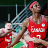Canada celebrate Mamadou Gueye's buzzer beater to beat England.